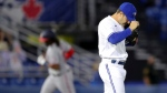 Toronto Blue Jays relief pitcher Ty Tice reacts after giving up a two-run home run to Washington Nationals' Josh Bell, rounding the bases in the background, during the fifth inning of a baseball game Wednesday, April 28, 2021, in Dunedin, Fla. (AP Photo/Mike Carlson)