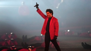 The Weeknd performs during halftime of the NFL Super Bowl 55 football game between during the halftime show of the NFL Super Bowl 55 football game between the Kansas City Chiefs and Tampa Bay Buccaneers, Sunday, Feb. 7, 2021, in Tampa, Fla. (AP Photo/David J. Phillip)