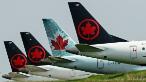 Grounded Air Canada planes sit on the tarmac at Pearson International Airport during the COVID-19 pandemic in Toronto on Wednesday, April 28, 2021. THE CANADIAN PRESS/Nathan Denette