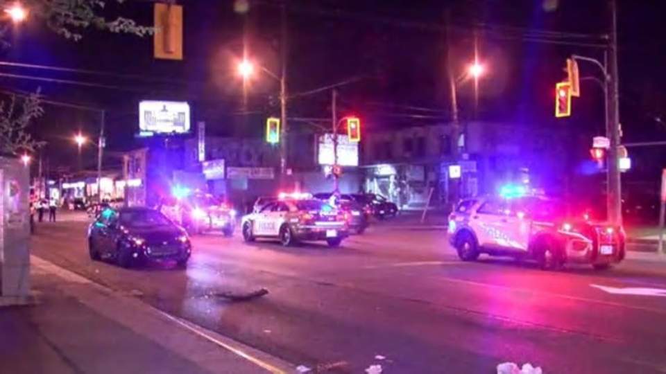 Police vehicles and a blue Toyota Corolla involved in a collision are seen on Jane Street on June 6, 2021. (CP24)