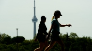 People are framed around the CN tower as they exercise in Toronto on Wednesday, June 2, 2021. THE CANADIAN PRESS/Nathan Denette