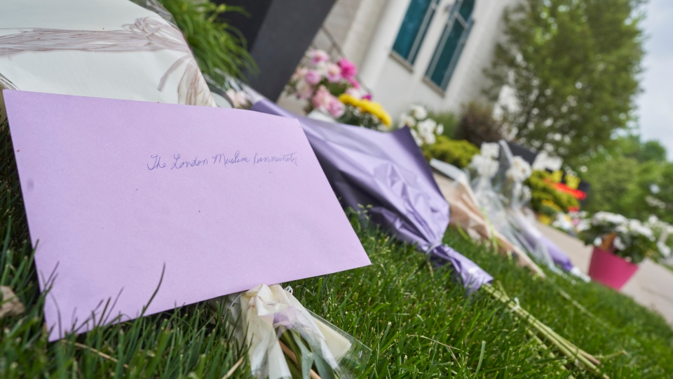 Flowers and cards lay outside the London Muslim Mosque in London, Ont. on Tuesday, June 8, 2021 after a hate-inspired terrorist attack on Sunday left four members of a Muslim family dead and their nine-year-old son in hospital. THE CANADIAN PRESS/ Geoff Robins