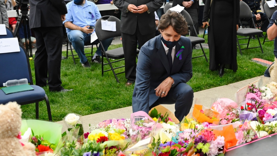 Prime Minister Justin Trudeau lays flowers at a vigil outside the London Muslim Mosque for the victims of the deadly vehicle attack on five members of the Canadian Muslim community in London, Ont., on Tuesday, June 8, 2021. Four of the members of the family died and one is in critical condition. Police have charged a London man with four counts of murder and one count of attempted murder. THE CANADIAN PRESS/Nathan Denette
