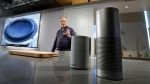 David Limp, senior vice president of Devices and Services at Amazon, displays a new Echo, left, and an Echo Plus during an event announcing several new Amazon products by the company, Wednesday, Sept. 27, 2017, in Seattle. On Tuesday, June 8, 2021 Amazon launched a program that forces users of many Echo smart speakers and Ring security cameras to automatically share a small portion of their wireless bandwidth with neighbors. The only way to stop it is to turn it off yourself. (AP Photo/Elaine Thompson)