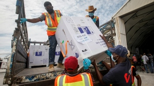 In this March 15, 2021, file photo, boxes of COVID-19 vaccine provided through the COVAX global initiative arrive at the airport in Mogadishu, Somalia. The Biden administration plans to provide 500 million shots purchased from Pfizer to 92 lower income countries and the African Union over the next year through the U.N.-backed COVAX program. (AP Photo/Farah Abdi Warsameh, File)