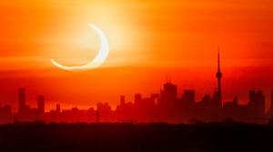 An annular solar eclipse rises over the skyline of Toronto on Thursday, June 10, 2021. THE CANADIAN PRESS/Frank Gunn