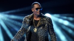 """FILE - R. Kelly performs at the BET Awards on June 30, 2013, in Los Angeles. The jailed R&B singer wants to shake up his legal defense team two months before he is set to go on trial in New York on federal racketeering charges. His top two attorneys, Steve Greenberg and Michael Leonard, of Chicago, filed a motion this week seeking to withdraw from the long-delayed case, saying it would be """"impossible"""" for them """"to properly represent Mr. Kelly under the current circumstances."""" (Photo by Frank Micelotta/Invision/AP, File)"""