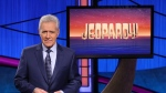 """FILE - This image released by Jeopardy! shows Alex Trebek, host of the game show """"Jeopardy!"""" Filling the void left by Trebek after 37 years involves sophisticated research and a parade of guest hosts doing their best to impress viewers and the studio that will make the call. (Jeopardy! via AP)"""