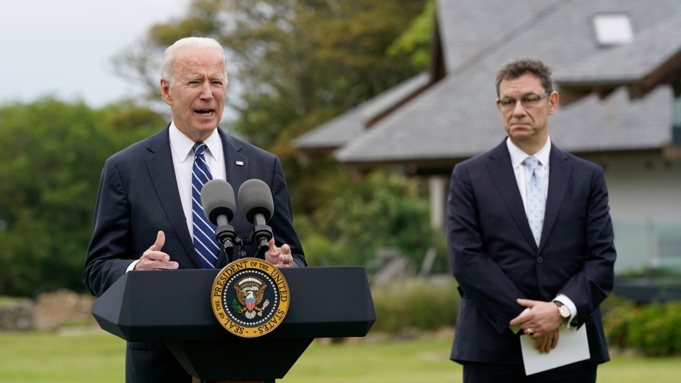 President Joe Biden speaks about his administration's global COVID-19 vaccination efforts ahead of the G-7 summit, Thursday, June 10, 2021, in St. Ives, England. Pfizer CEO Albert Bourla listens at right. (AP Photo/Patrick Semansky)