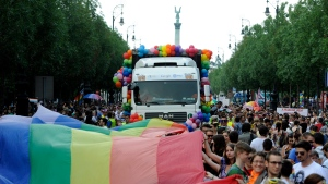 In this Saturday, July 6 2013 file photo participants walk down Andrassy Street under a giant rainbow flag during the 18th Budapest Gay Pride March in Budapest, Hungary. (AP Photo/MTI, Imre Foldi, file)
