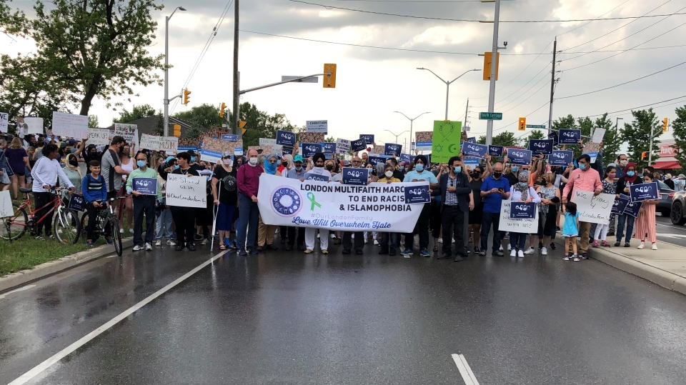 Hundreds gather in London, Ont. for a multi-faith march to honour the victims of the anti-Muslim attack earlier this week. (CP24/Simon Sheehan)