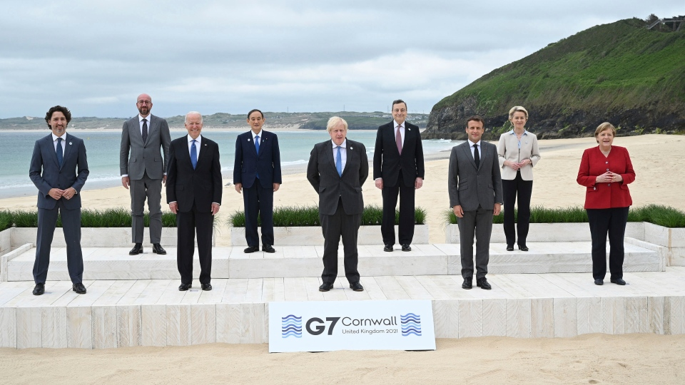 From left, Canadian Prime Minister Justin Trudeau, President of the European Council Charles Michel, US President Joe Biden, Japanese Prime Minister Yoshihide Suga, British Prime Minister Boris Johnson, Italian Prime Minister Mario Draghi, French President Emmanuel Macron, President of the European Commission Ursula von der Leyen and German Chancellor Angela Merkel, during the leaders official welcome and family photo in Carbis Bay England on Friday, June 11, 2021. (Leon Neal/Pool Photo via AP)