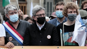 """President of the French leftist """"La France Insoumise"""" party Jean-Luc Melenchon, center, attends a demonstration, Saturday, June 12, 2021 in Paris. Thousands of people rallied throughout France Saturday to protest against the far-right. (AP Photo/Lewis Joly)"""