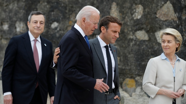 French President Emmanuel Macron, second right, and U.S. President Joe Biden, second left, walk along the boardwalk during the G7 meeting at the Carbis Bay Hotel in Carbis Bay, St. Ives, Cornwall, England, Friday, June 11, 2021. Leaders of the G7 begin their first of three days of meetings on Friday, in which they will discuss COVID-19, climate, foreign policy and the economy. (Phil Noble, Pool via AP)