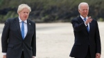 Britain's Prime Minister Boris Johnson poses with U.S. President Joe Biden during arrivals for a G7 meeting at the Carbis Bay Hotel in Carbis Bay, St. Ives, Cornwall, England, Friday, June 11, 2021. Leaders of the G7 begin their first of three days of meetings on Friday, in which they will discuss COVID-19, climate, foreign policy and the economy. (Phil Noble, Pool via AP)
