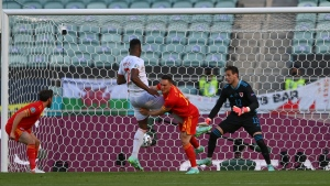 Switzerland's Breel Embolo, 2nd left, scores his side's opening goal during the Euro 2020 soccer championship group A match between Wales and Switzerland, at the Baku Olympic stadium, in Baku, Azerbaijan, Saturday, June 12, 2021. (Ozan Kose, Pool via AP)