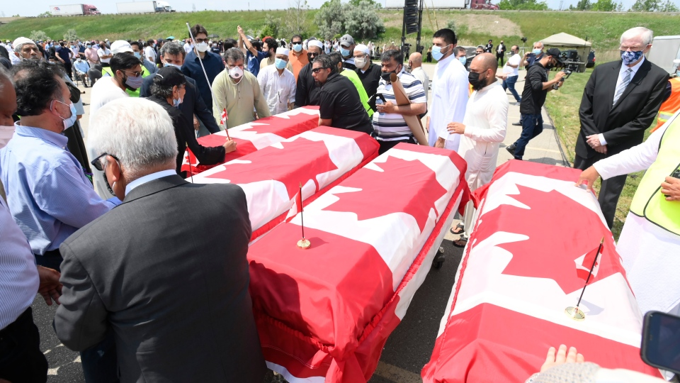 Caskets draped in Canadian flags arrive at a funeral for the four Muslim family members killed in a deadly vehicle attack, at the Islamic Centre of Southwest Ontario in London, Ont., on Saturday, June 12, 2021. Talat Afzaal, 74, her son Salman Afzaal, 46, his wife Madiha Salman, 44, and their 15-year-old daughter Yumna Salman all died last Sunday night while out for a walk after a man in a truck drove them down in what police have called a premeditated attack because they were Muslim. THE CANADIAN PRESS/Nathan Denette-Pool