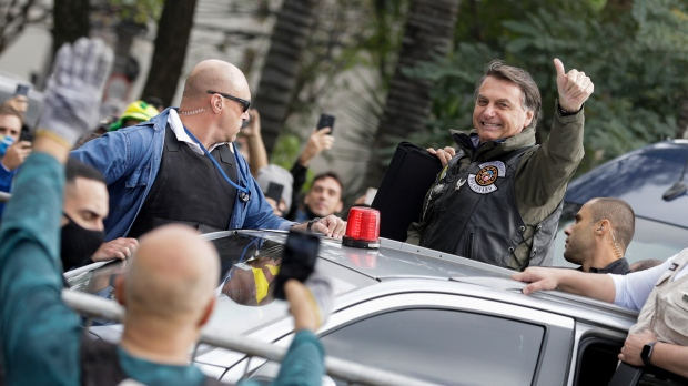 Brazil's President Bolsonaro fined for flouting mask order at motorcycle rally