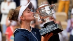 Czech Republic's Barbora Krejcikova kisses the cup after defeating Russia's Anastasia Pavlyuchenkova in their final match of the French Open tennis tournament at the Roland Garros stadium Saturday, June 12, 2021 in Paris. The unseeded Czech player defeated Anastasia Pavlyuchenkova 6-1, 2-6, 6-4 in the final. (AP Photo/Michel Euler)