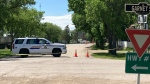 A police vehicle is shown on a street in Wolseley, Sask., Saturday, June 12, 2021. Residents of a Saskatchewan town are awaiting details about why many officers remain in their community following a serious crash. THE CANADIAN PRESS/HO-Tim Taylor MANDATORY CREDIT