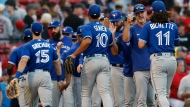 The Toronto Blue Jays celebrate after defeating the Boston Red Sox in a baseball game, Saturday, June 12, 2021, in Boston. (AP Photo/Michael Dwyer)