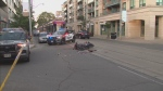 Police are investigating a collision in The Beaches that sent two people to hospital.