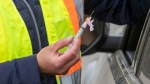 A syringe of Moderna COVID-19 vaccine is seen at a drive-thru clinic at Richardson Stadium in Kingston, Ont., on Friday, May 28, 2021. THE CANADIAN PRESS/Lars Hagberg