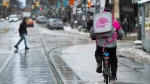 A Foodora courier is pictured as they pick up an order for delivery from a restaurant in Toronto on February 27, 2020. Food delivery app Foodora has filed for insolvency as it prepares to close its Canadian operations in a couple of weeks. The subsidiary of Berlin-based Delivery Hero SE filed a notice of intention to make a proposal to employees and other creditors under Section 50.4(1) of the Bankruptcy and Insolvency Act (Canada). Foodora owes more than $4.7 million to hundreds of restaurants, liquor outlets, governments and employees, according to a court filing by trustee Grant Thornton Ltd. on Monday. THE CANADIAN PRESS/Nathan Denette