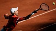 Serbia's Novak Djokovic returns the ball to Stefanos Tsitsipas of Greece during their final match of the French Open tennis tournament at the Roland Garros stadium Sunday, June 13, 2021 in Paris. (AP Photo/Thibault Camus)