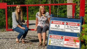 Paula Jongerden and Richelle Spanjers by a sign next to their properties in Norfolk County on Thursday June 10, 2021. THE CANADIAN PRESS/Frank Gunn