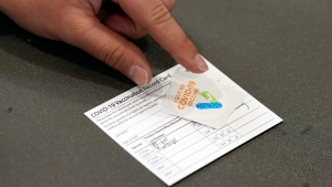 FILE - In this April 13, 2021, file photo, a COVID-19 vaccination card is displayed at the Banning Recreation Center in Wilmington, Calif. (AP Photo/Marcio Jose Sanchez, File)