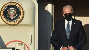 U.S. President Joe Biden arrives at Melsbroek Military Airport ahead of a NATO summit in Brussels, Sunday, June 13, 2021. U.S. President Joe Biden and his NATO counterparts are bidding a symbolic farewell to Afghanistan at their last summit on Monday before the U.S.-led organization pulls out its troops for good. (Benoit Doppagne, Pool via AP)