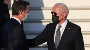 Belgium's Prime Minister Alexander De Croo, left, greets U.S. President Joe Biden as he arrives at Melsbroek Military Airport ahead of a NATO summit in Brussels, Sunday, June 13, 2021. U.S. President Joe Biden and his NATO counterparts are bidding a symbolic farewell to Afghanistan at their last summit on Monday before the U.S.-led organization pulls out its troops for good. (Yves Herman, Pool via AP)
