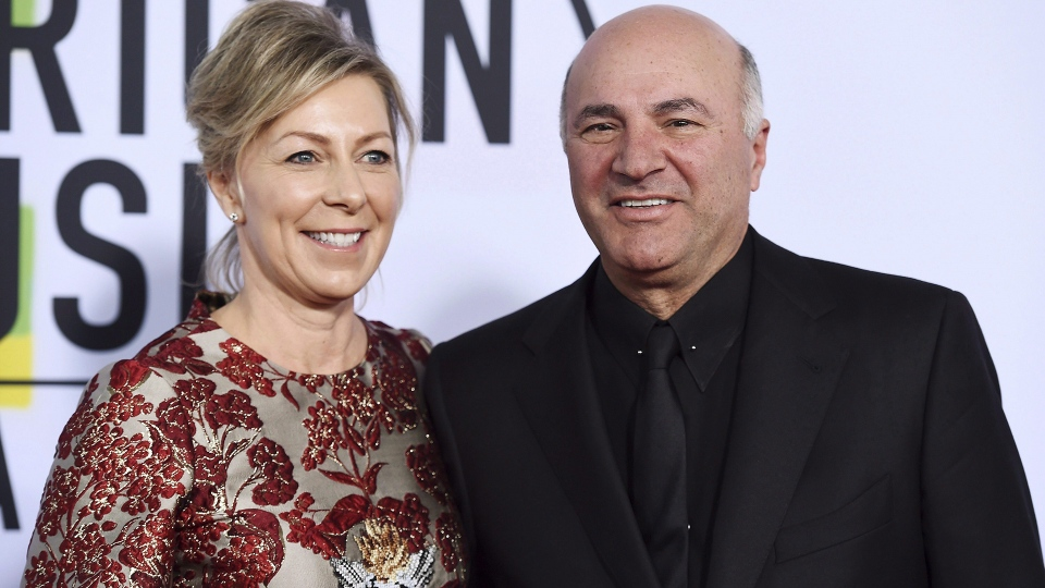Linda O'Leary and Kevin O'Leary arrive at the American Music Awards at the Microsoft Theater in Los Angeles. A lawyer for Linda O'Leary, the wife of celebrity businessman Kevin O'Leary, says his client was not impaired when she got involved in a boat crash on an Ontario lake that left two people dead. THE CANADIAN PRESS/AP, Jordan Strauss/Invision