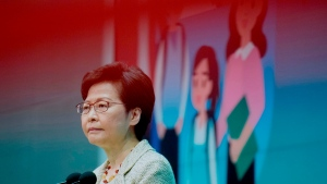 """Hong Kong Chief Executive Carrie Lam listens to reporters' questions during a press conference in Hong Kong, Tuesday, June 15, 2021. Lam said that her government is """"highly concerned"""" about the situation at a nearby nuclear power plant in mainland China, following media reports that the plant could be experiencing a leak. (AP Photo/Vincent Yu)"""