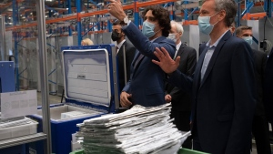 Canadian Prime Minister Justin Trudeau is given a tour of a vaccine facility by Pfizer Director of Aseptic Manufacturing Koen Vastenavond on Tuesday June 15, 2021 in Puurs, Belgium. THE CANADIAN PRESS/Adrian Wyld
