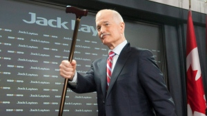 NDP Leader Jack Layton raises his cane as leaves a news conference in Ottawa, Monday April 11, 2011 after speaking about the Auditor-General's report on the G8. THE CANADIAN PRESS/Adrian Wyld