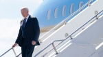 President Joe Biden steps off Air Force One at Geneva Airport in Geneva, Switzerland, Tuesday, June 15, 2021. Biden is scheduled to meet with Russian President Vladimir Putin in Geneva, Wednesday, June 16, 2021. (AP Photo/Patrick Semansky)
