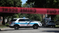 Police tape marks off a Chicago street as officers investigate the scene of a fatal shooting in the city's South Side on Tuesday, June 15, 2021. An argument in a house erupted into gunfire early Tuesday, police said. (AP Photo/Teresa Crawford)