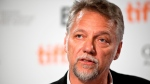 In this file photo, Edward Burtynsky speaks at a press conference to announce the line-up of Canadian films that will be screened at the Toronto International Film Festival, in Toronto on August 7, 2013. THE CANADIAN PRESS/Galit Rodan