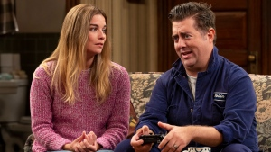 """This image released by AMC shows Annie Murphy, left, and Eric Petersen in a scene from the comedy series """"Kevin Can F*** Himself."""" (Jojo Whilden/AMC via AP)"""