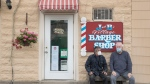 Customers wait their turn outside at J & B Barbershop in Fenelon Falls, Ontario on Friday June 12, 2020.  THE CANADIAN PRESS/Fred Thornhill