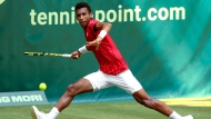 Canada's Felix Auger-Aliassime plays a forehand during his ATP Tour Singles, Men, Round of 16 tennis match against Switzerland's Roger Federer in Halle, Germany, Wednesday, June 16, 2021. (Friso Gentsch/dpa via AP)