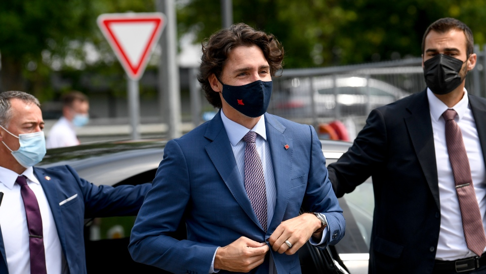 Canada's Prime Minister Justin Trudeau, center, arrives for a working visit to the Pfizer pharmaceutical company in Puurs, Belgium, Tuesday, June 15, 2021. Canadian Prime Minister Justin Trudeau paid a visit to the Belgian Pfizer factory on Tuesday to thank employees making the COVID-19 vaccine. (Frederic Sierakowski, Pool via AP)
