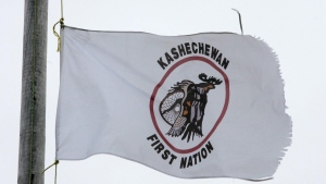 A tattered Kashechewan First Nation flag flies outside St. Paul's Anglician church on the Kashechewan native reserve in northern Ontario Sunday, Oct. 30, 2005. THE CANADIAN PRESS/Jonathan Hayward
