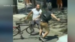 This image taken from a social media video shows a driver involved in a violent altercation with a cyclist near College and Dufferin streets.