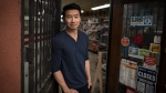 Actor Simu Liu of Kim's Convenience, poses for a photograph on set following an interview in Toronto on Wednesday, July 24, 2019. THE CANADIAN PRESS/Tijana Martin