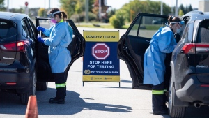 Paramedics administer nasal swabs at a drive through, pop-up COVID-19 test centre on Sunday, Sept. 20, 2020. THE CANADIAN PRESS/Justin Tang