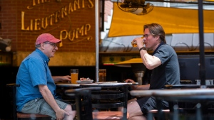 People have drinks on an outdoor patio at a pub in Ottawa, as Ontario enters the first phase of its re-opening plans amidst the third wave of the COVID-19 pandemic, on Friday, June 11, 2021. THE CANADIAN PRESS/Justin Tang