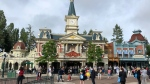 Visitors wait to enter Disneyland Paris in Marne-la-Vallée, east of Paris, Thursday, June 17, 2021. France's tourism sector takes a further step toward post-pandemic recovery with the reopening of Disneyland Paris, two weeks after the country formally welcomed back vaccinated foreign visitors. (AP Photo/Catherine Gaschka)
